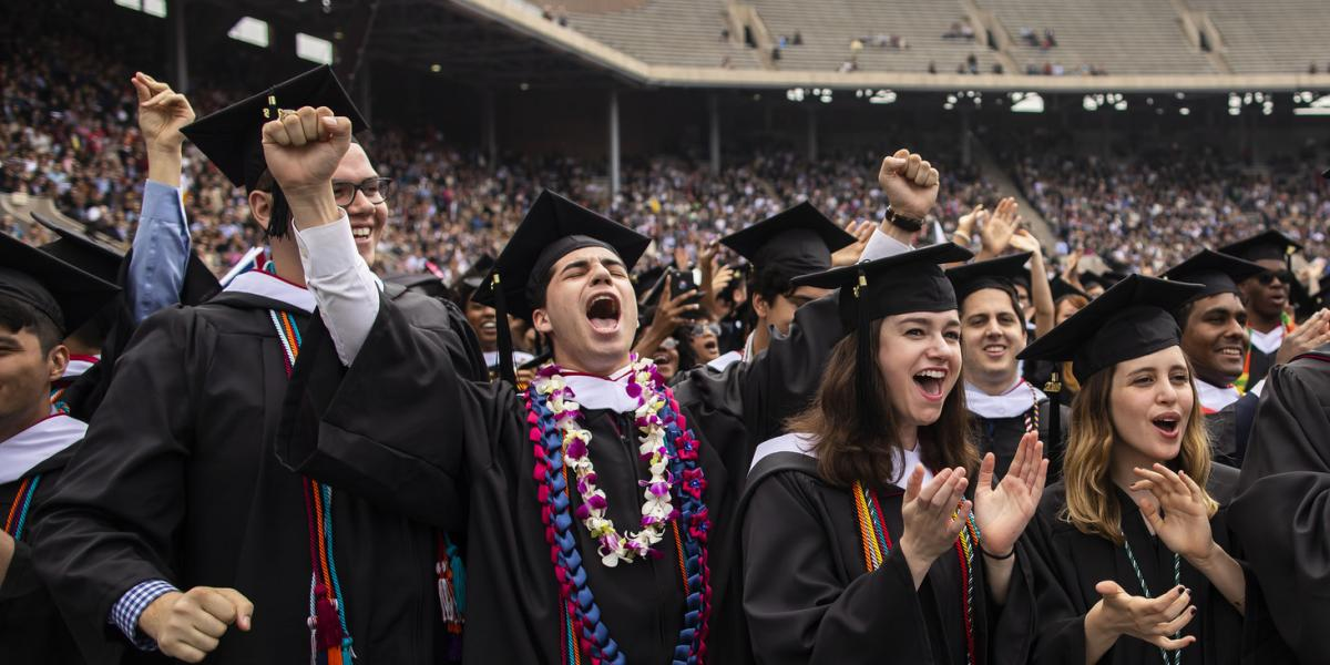 Graduates cheering at commencement